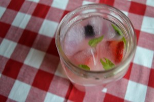 Berry lemonade ice cubes in lemonade mimosa