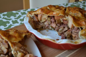Slice of rhubarb and apple pie